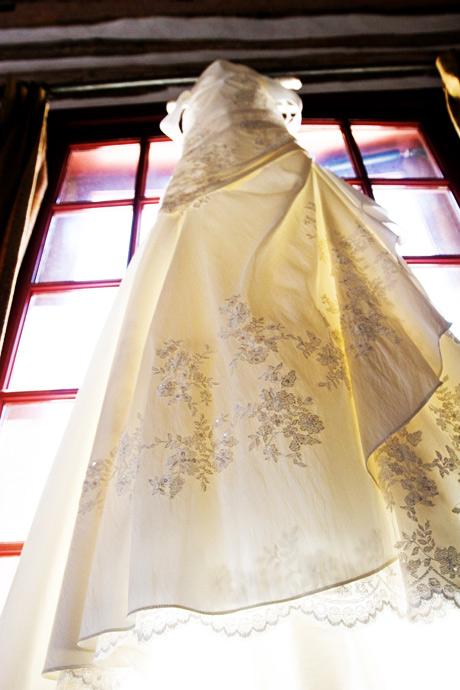 Wedding dress hanging in the window at Figueroa Mountain Farmhouse