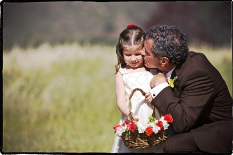 Flower girl and father of the bride during wedding ceremony at Figueroa Mountain Farmhouse Wedding