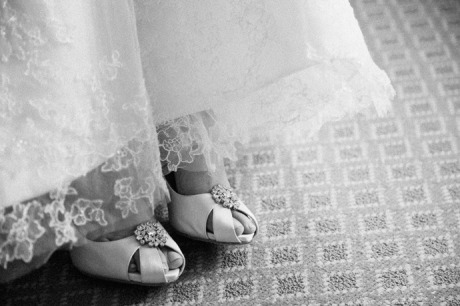 Close-up of bride's shoes as she gets ready at the Langham Hotel