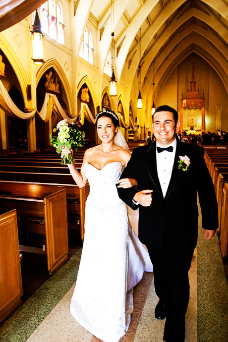Bride and Groom exiting after their wedding ceremony in Los Angeles, California.