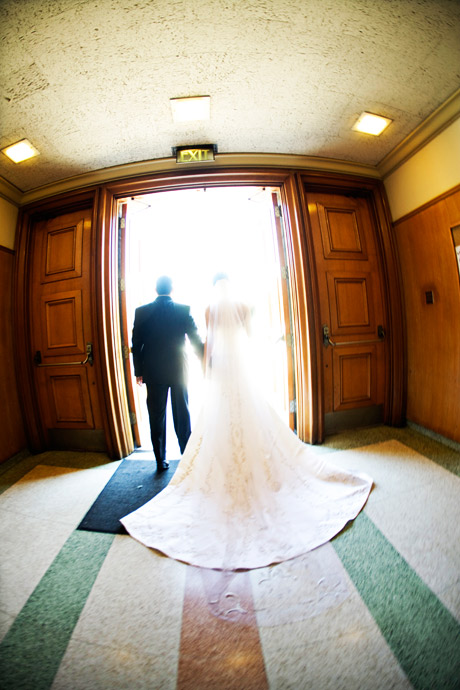 Bride and Groom exiting the Church after Catholic Wedding Ceremony in Los Angeles, California.