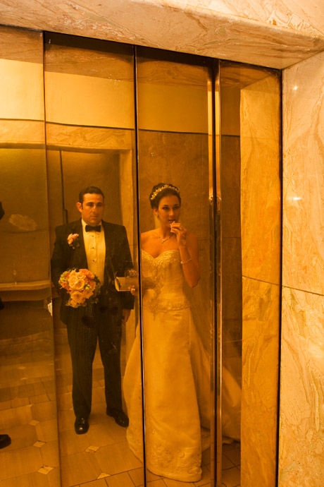 Reflection of Bride and Groom on their way up to their Wedding Reception at the Marina Del Rey Marriott in Los Angeles, California