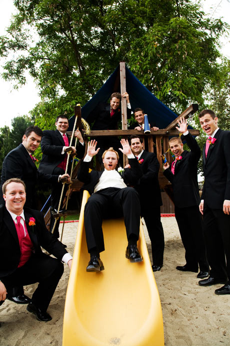 Groom on the slide at Messiah Lutheran Church Wedding