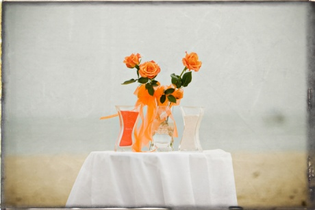 Flowers and Unity Sand are set up before the Santa Barbara Beach Wedding Ceremony.