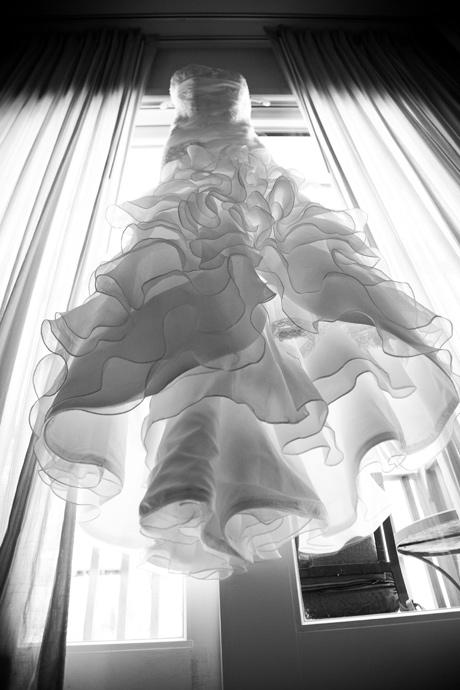 Wedding Dress hanging in the window at Estancia Hotel and Spa in La Jolla, San Diego, Califorina