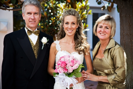 Bride and her parents before the wedding ceremony at St. James Anglican Church