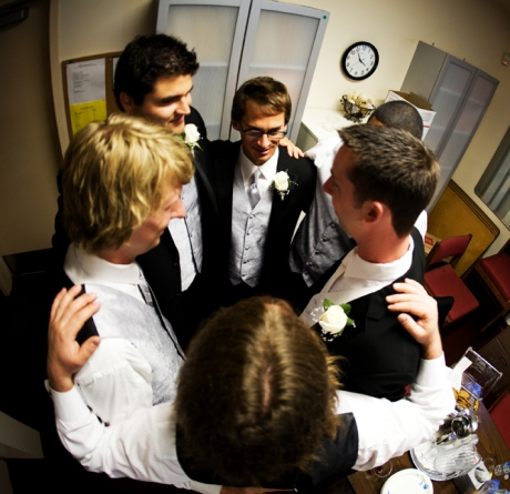 Groom and his guys in prayer before the wedding ceremony at St. James Anglican Church