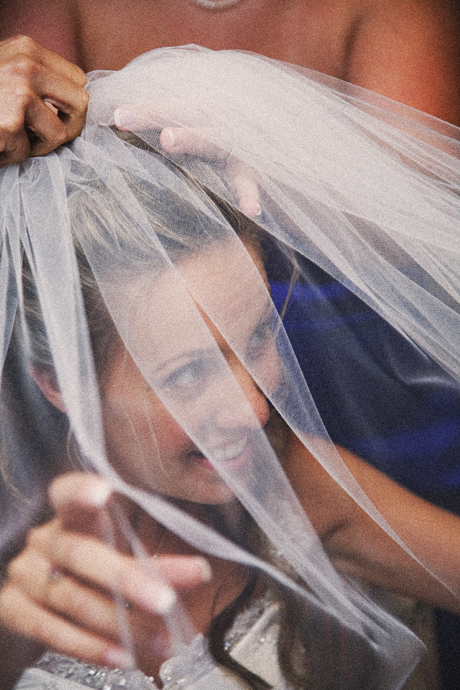 Bride getting her veil on with help from her bride's maids at St. James Anglican Church.