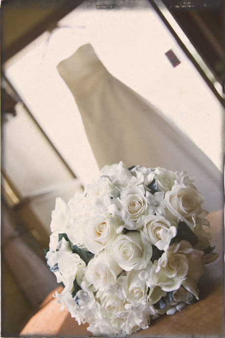 Bridal bouquet and wedding dress at St. Lawrence Martyr Church in Redondo Beach, California