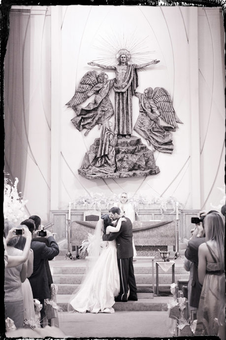 Bride and Groom have their first kiss as a married couple at St. Lawrence Catholic Church in Redondo Beach, CA