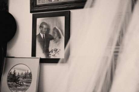 Bridal veil with her parent's wedding picture in the background