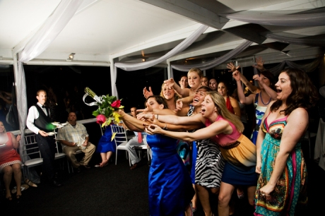 Single ladies dive for the bouquet aboard Electra Cruises Yacht in Newport Beach