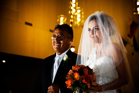 Bride and her fatehr walking down the aisle in Orange County