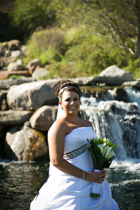 Bride by the waterfall at Black Gold Golf Club