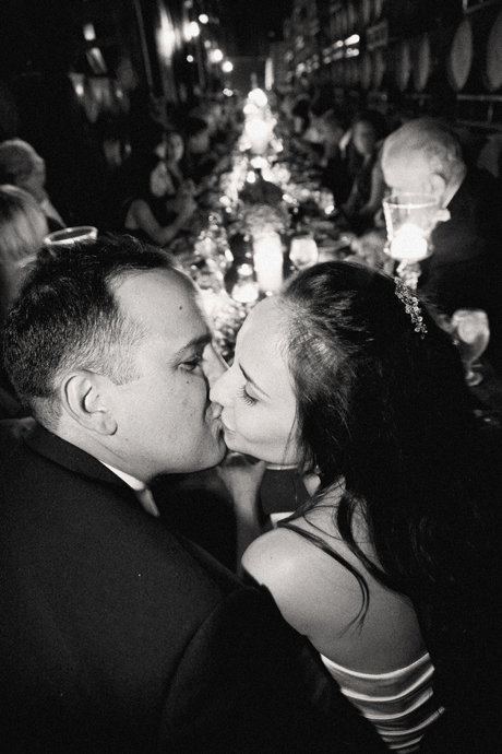 Bride and Groom kiss at the head of the table