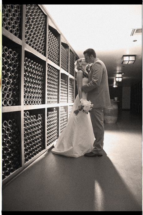 Bride and Groom in the Wine Cellar at Gainey Vineyard