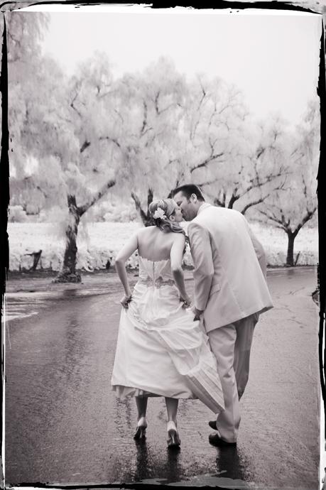 So Romantic! Kiss in the rain at Gainey Vineyard.