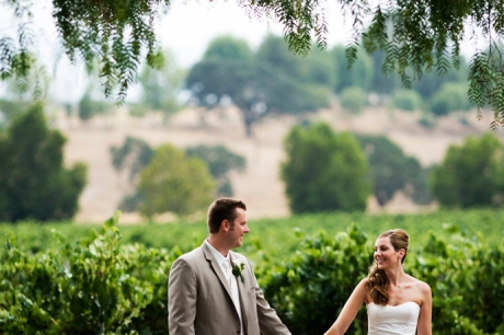 Almost Married! Bride and Groom hold hands at Gainey Vineyard.
