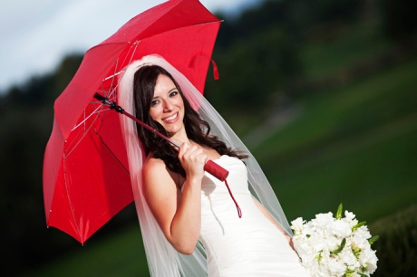 Bride in the rain at Aliso Viejo Conference Center