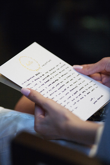 Bride reads note from groom