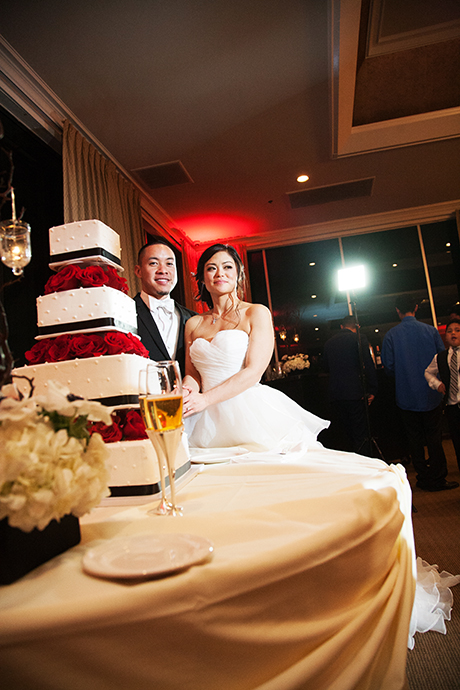 Bride and Groom Cut Wedding Cake
