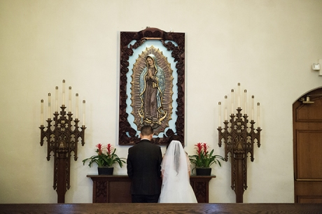 Bride and Groom Give Flowers to Virgin Mary